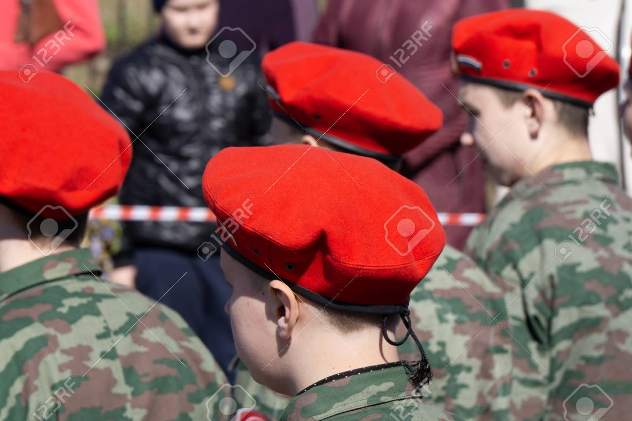 73aa3b846a6a Military kid wearing red beret next to a Russian flag back view. Patriotic  Young boy