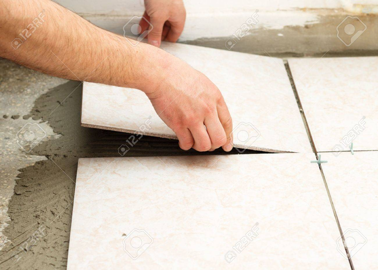 handyman doing tiling works in kitchen stock photo picture and