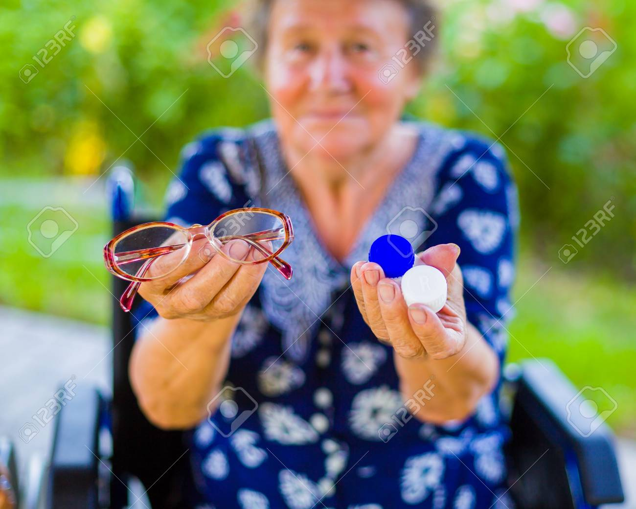 Pensioner woman with hard choice between contact lens and eye