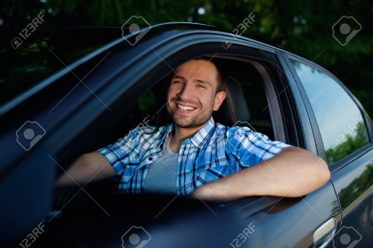 Handsome man smiling in his own car Stock Photo - 11570729
