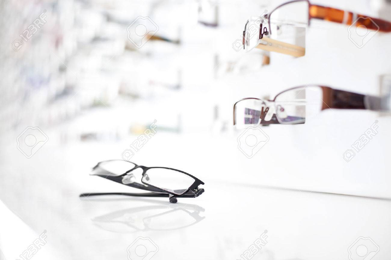Closeup of glasses with many eyeglasses in background - 53939288