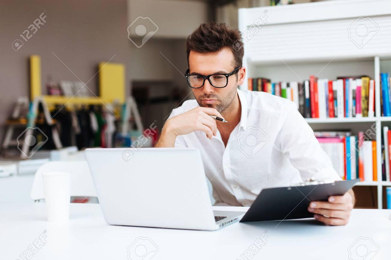 Designer working with laptop - 53951383