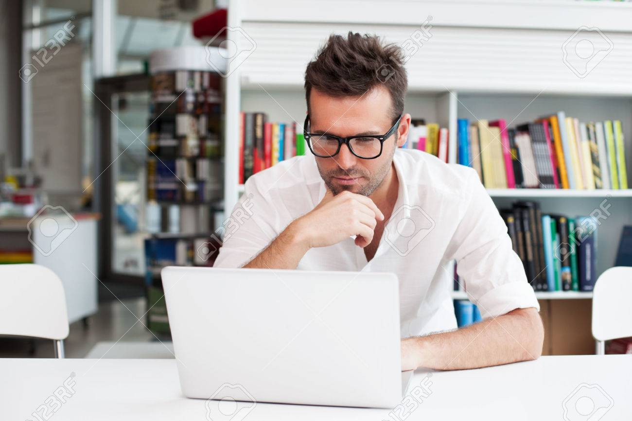 Happy Man Working On Laptop Stock Photo, Picture And Royalty Free Image.  Image 53952283.