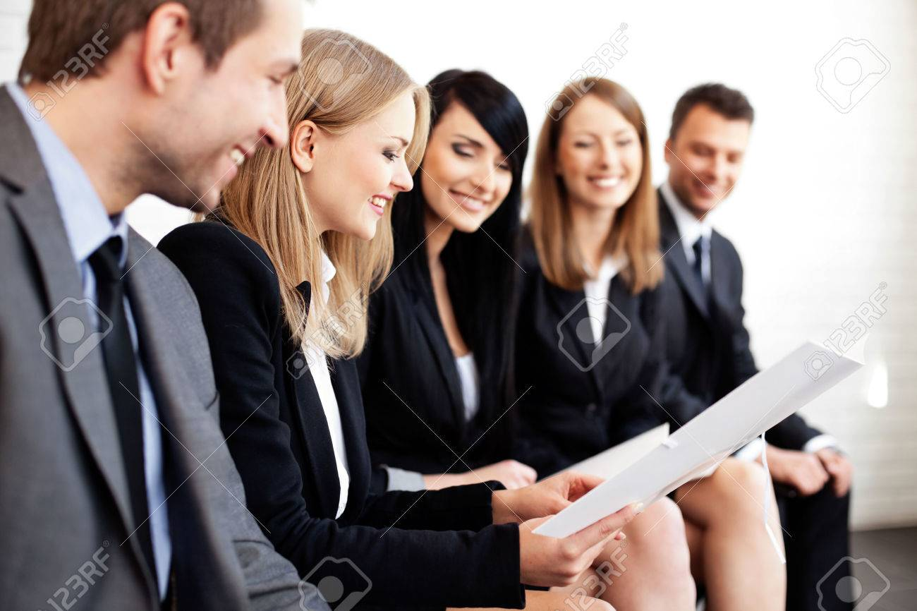 Gruop of business people. Businesswoman explaining Standard-Bild - 53952507