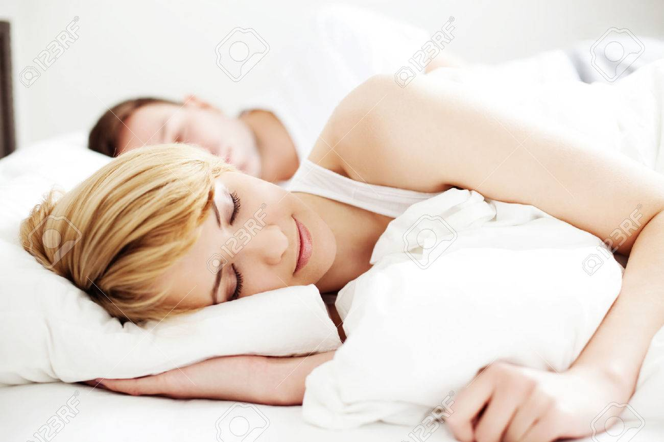 Portrait of couple sleeping in the bed Standard-Bild - 53953151
