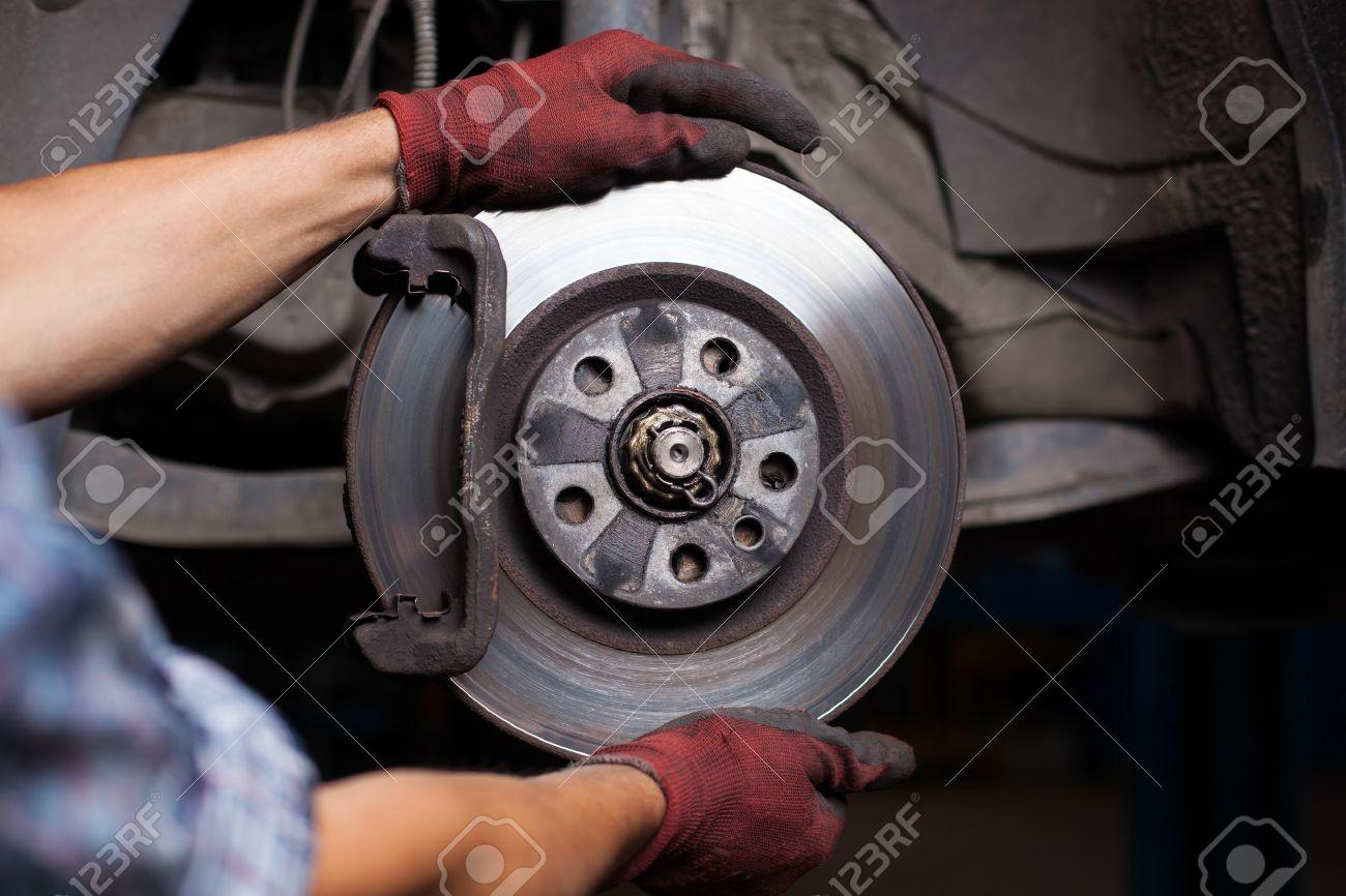 Repairing brakes on car Standard-Bild - 53953182