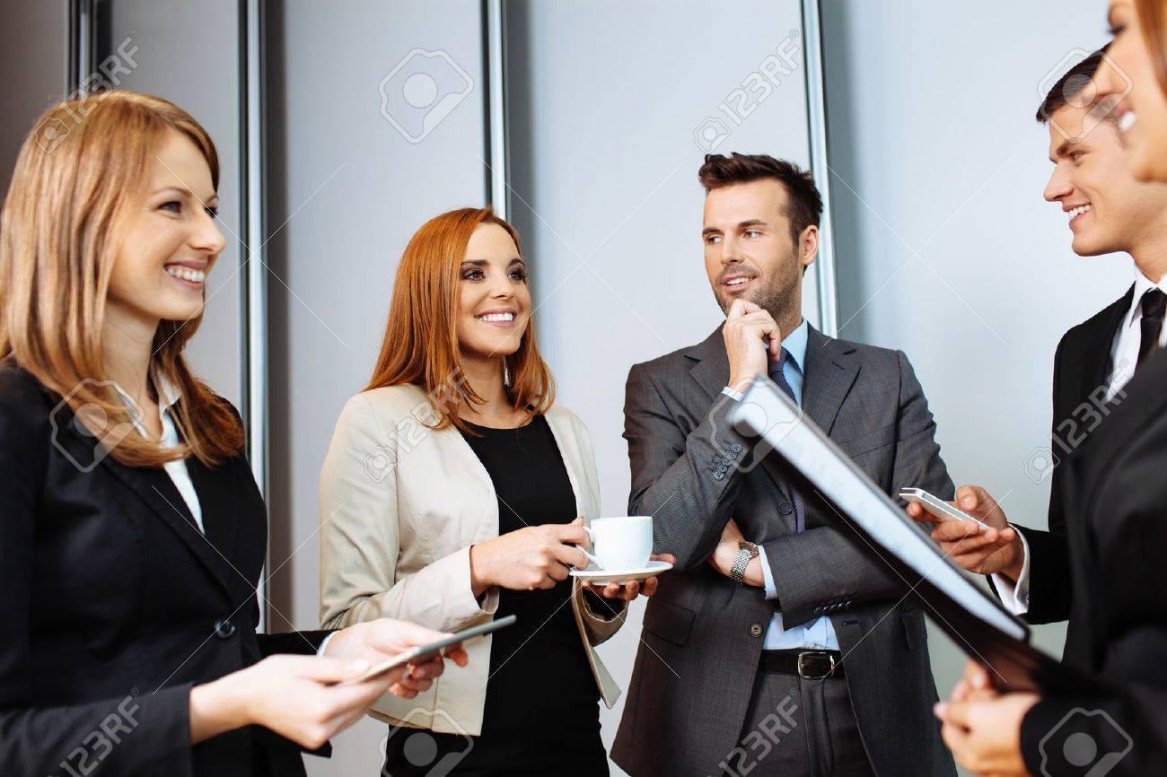 Business people talking during conference break; networking Standard-Bild - 53953646