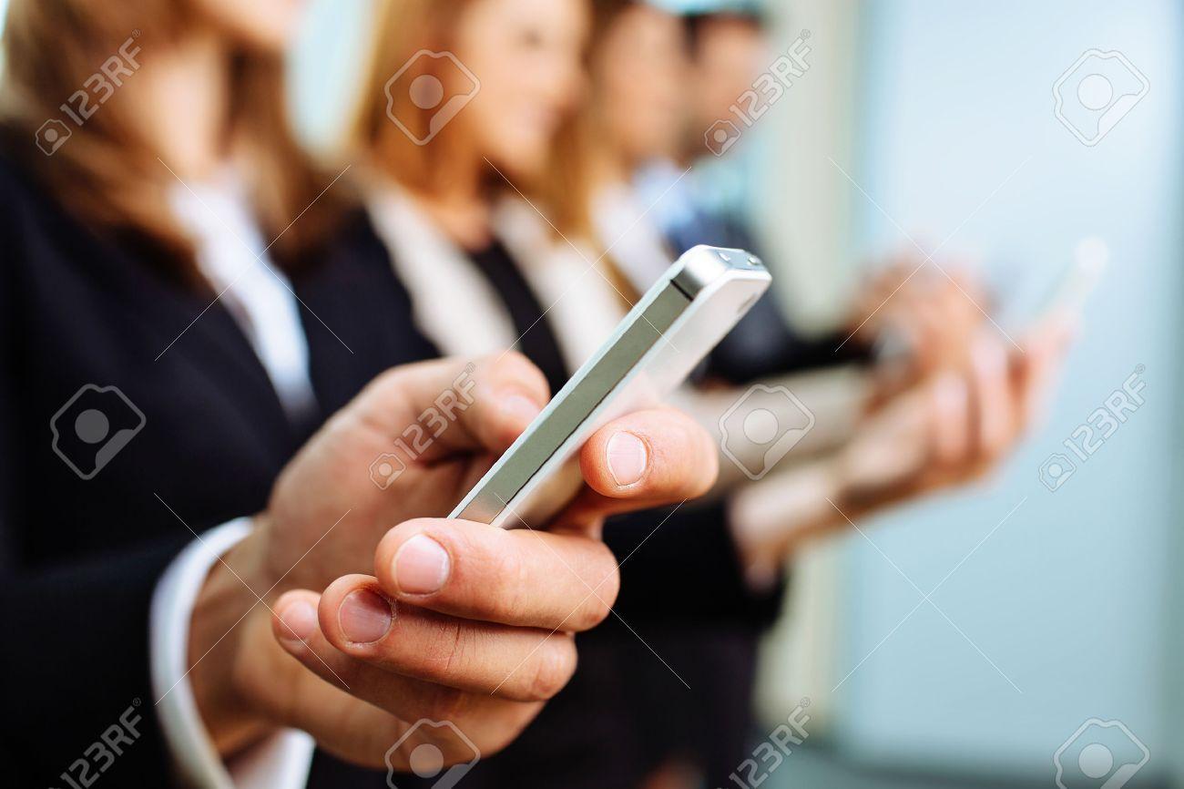 Close up of businessman using smartphone. Business concept Standard-Bild - 53953831