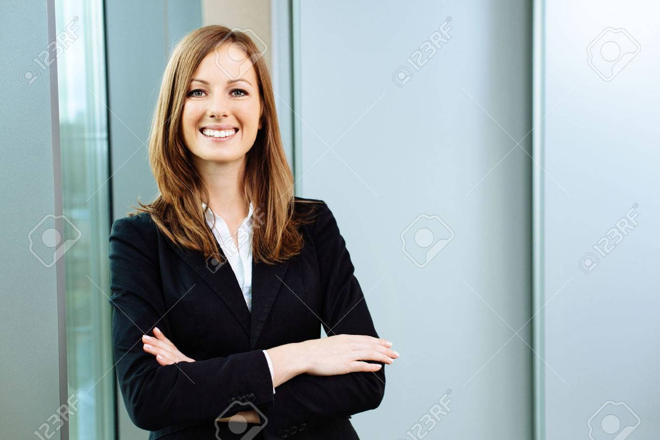 Confident business woman stands in the office - 53954706
