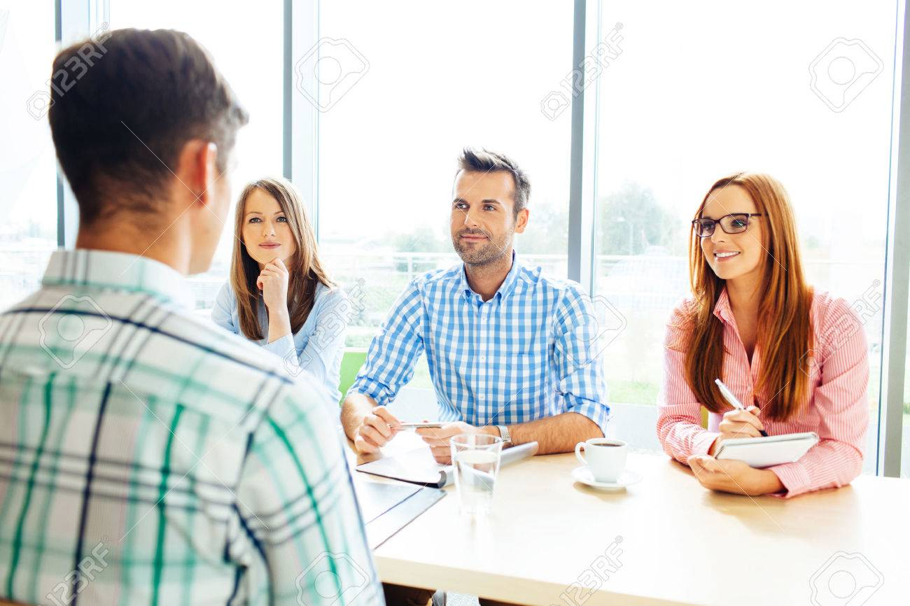 Recruitment. Three corporate people Interview young man - 53954708