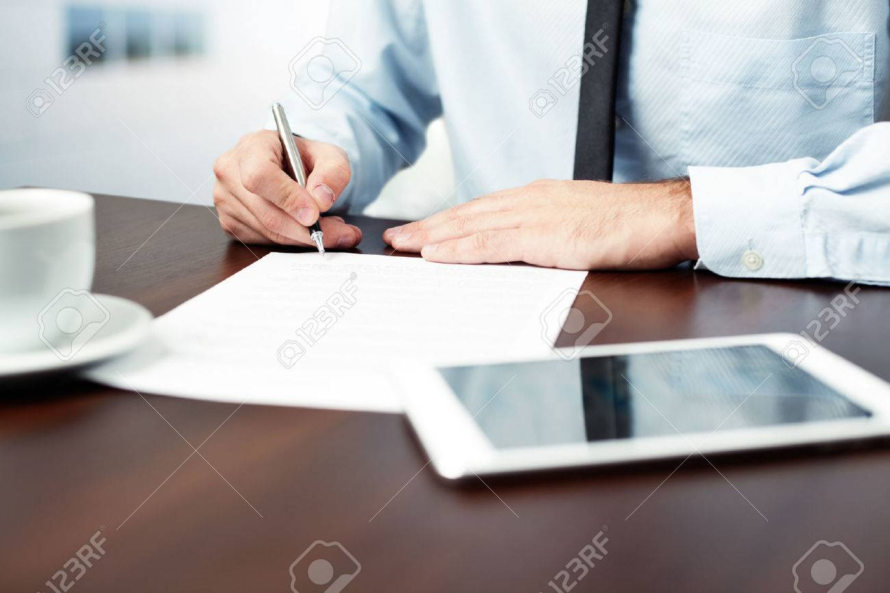 Businessman signing contract. - 53957457