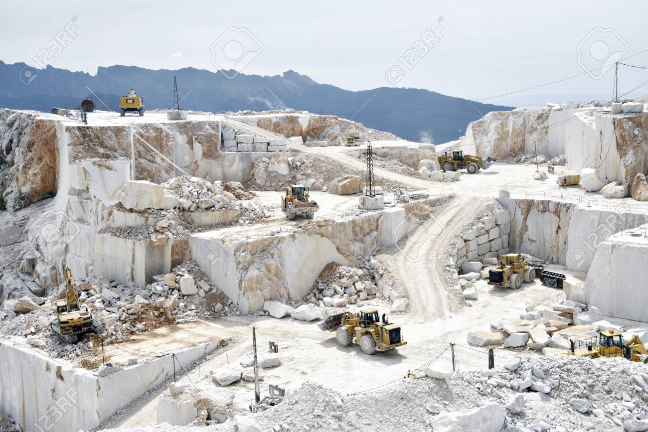 Carrara Marble Quarry In Italy With Bulldozers At Work Stock Photo, Picture  And Royalty Free Image. Image 107520972.