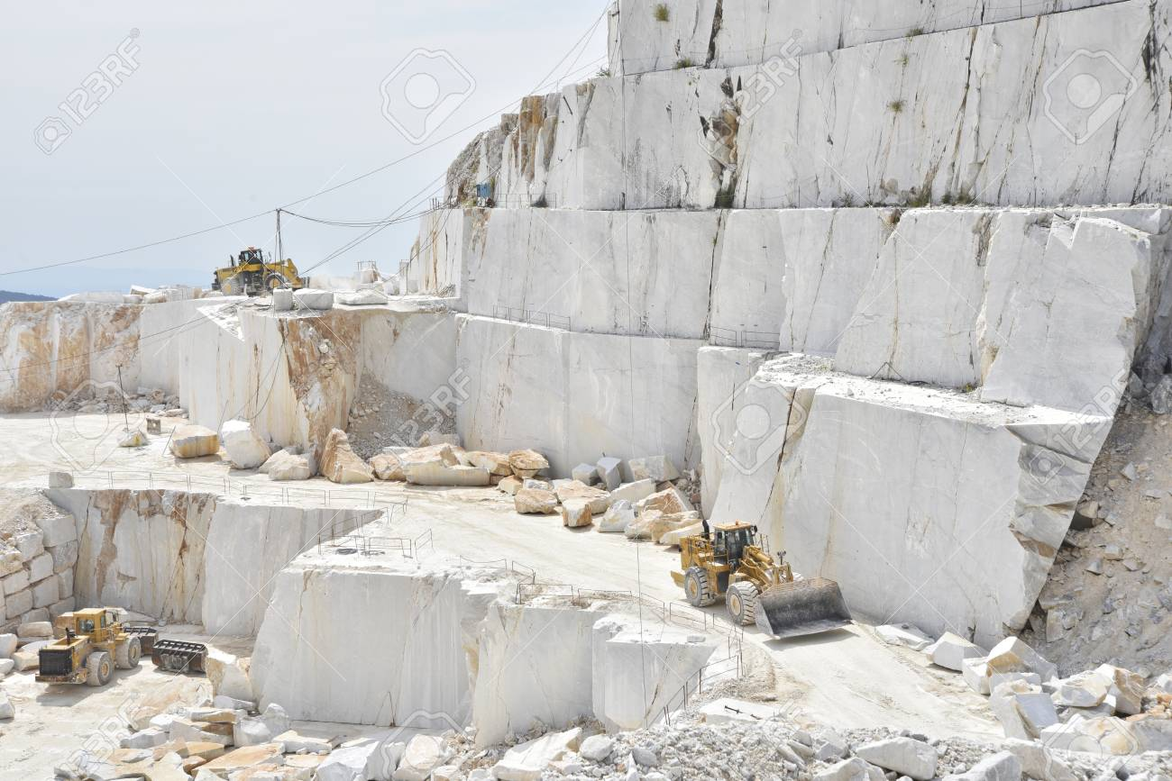 Carrara marble quarry in Italy with bulldozers at work