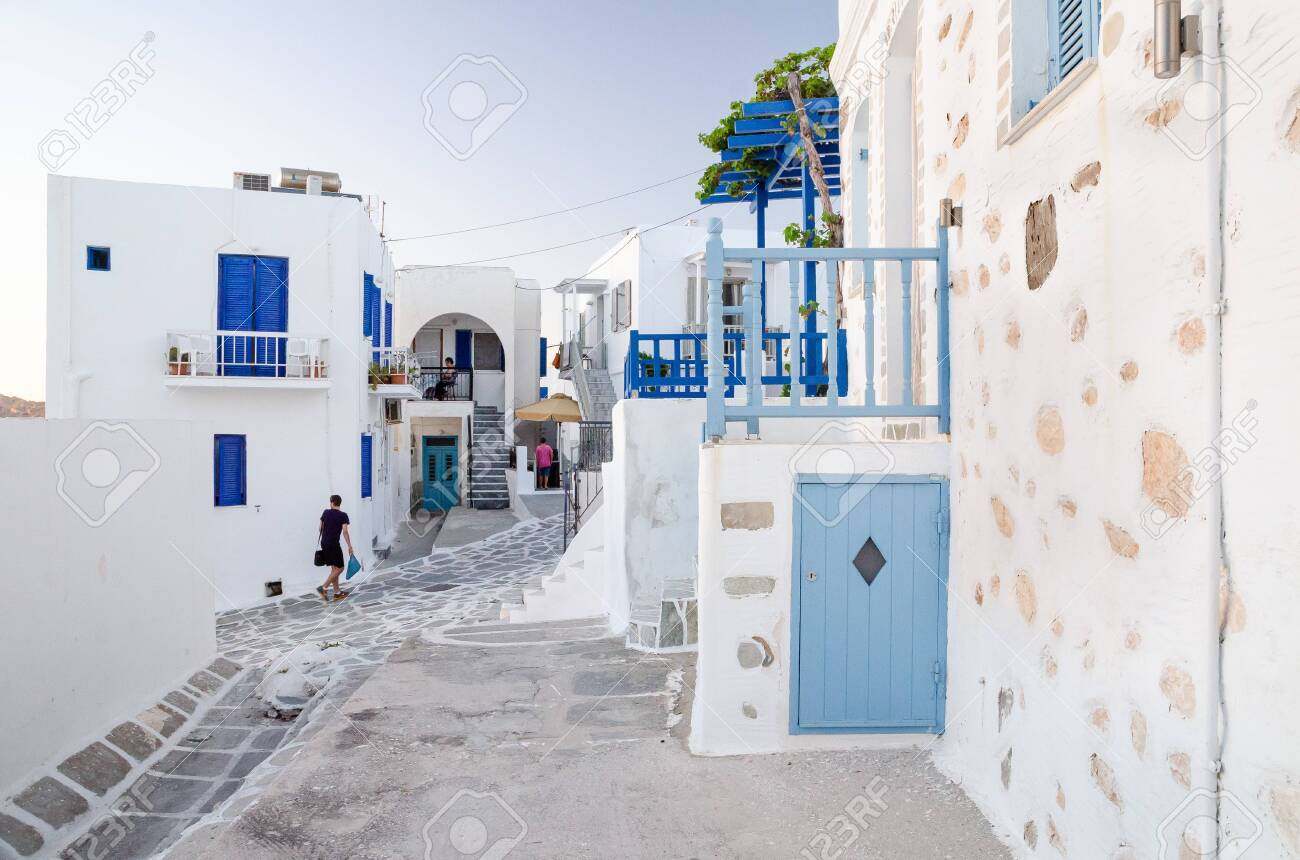 A typical street with white houses in Paros or Parikia, Cyclades islands, Greece - 141905139