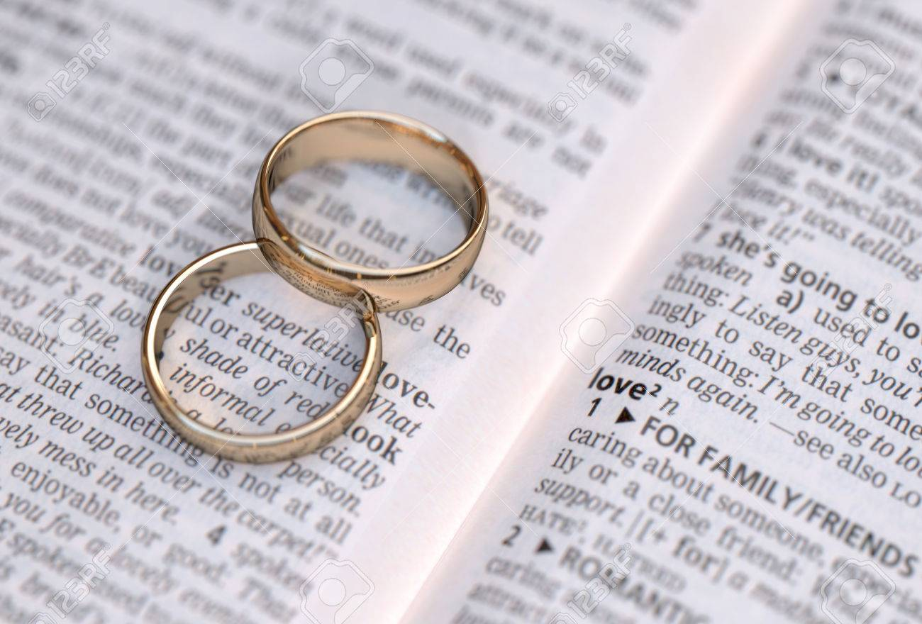 Wedding Rings On A Dictionary Page Showing Love Definition Stock