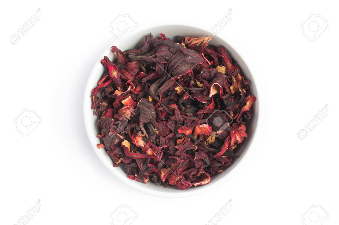 Dried Hibiscus Flower Into A Bowl In White Background Stock Photo