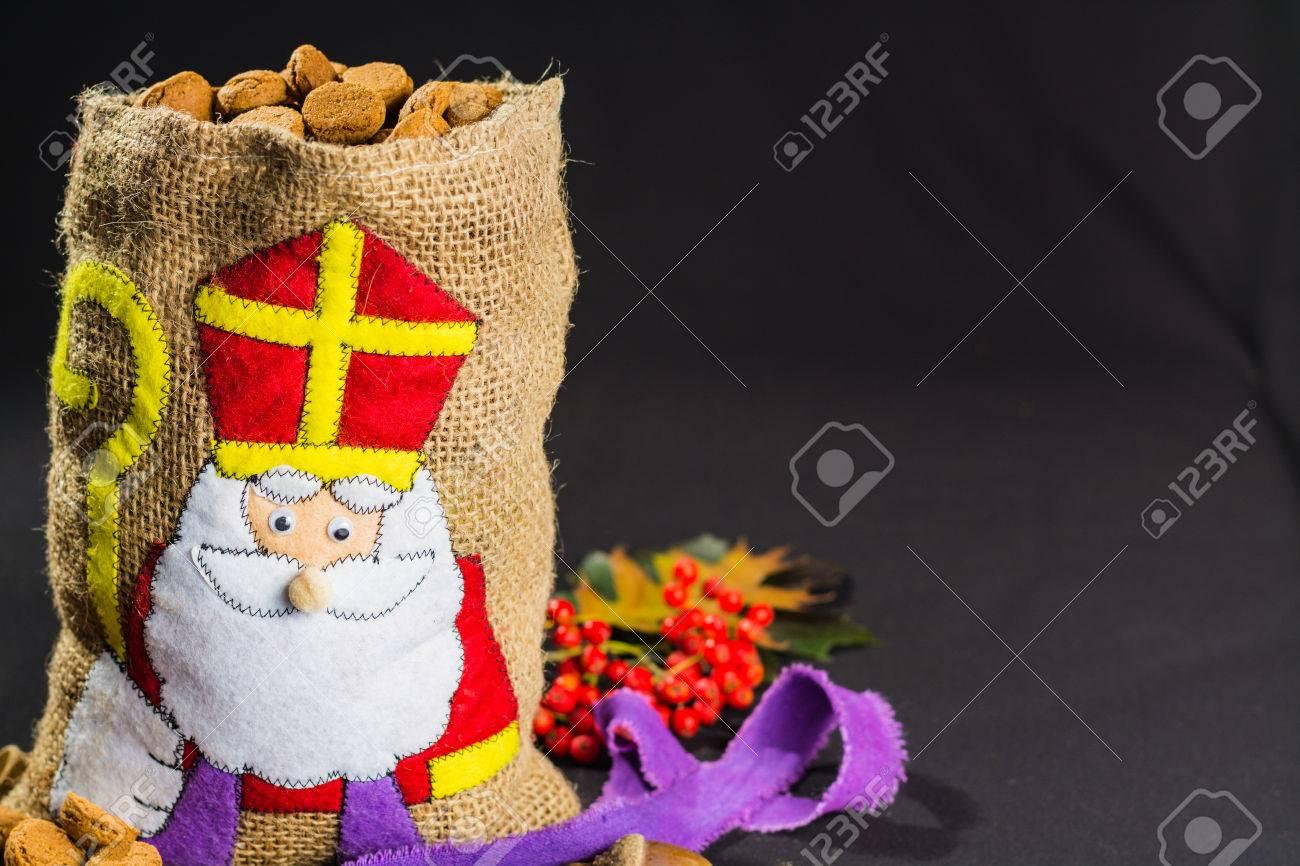 'De zak van Sinterklaas' (St. Nicholas' bag) filled with 'pepernoten'. Traditional Dutch holiday 'Sinterklaas'. - 65664854