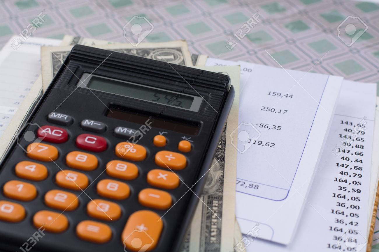 Utility or mortgage bills, calculator and US dollars - finance concept, payments and problems - 66320232