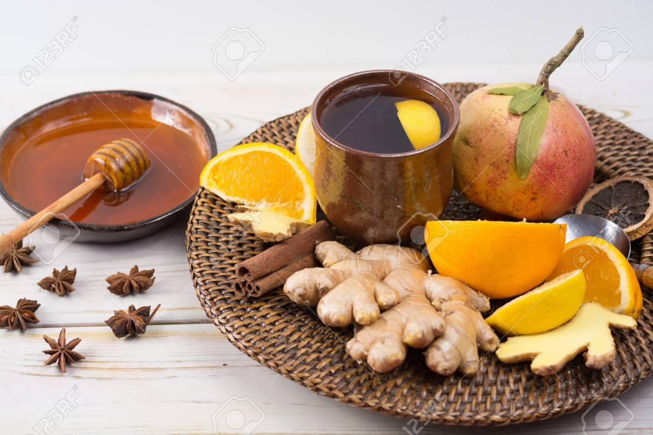 Natural flu and cold remedy - orange and lemon fruit, fresh ginger, honey - alternative medicine, health concept - 66414120