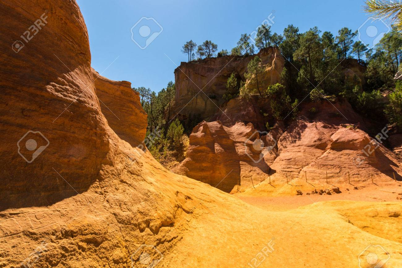 Oragne ochre picturesque hills. Languedoc - Roussillon, Provence, France. Preserve natural dye production - ocher. - 71037506