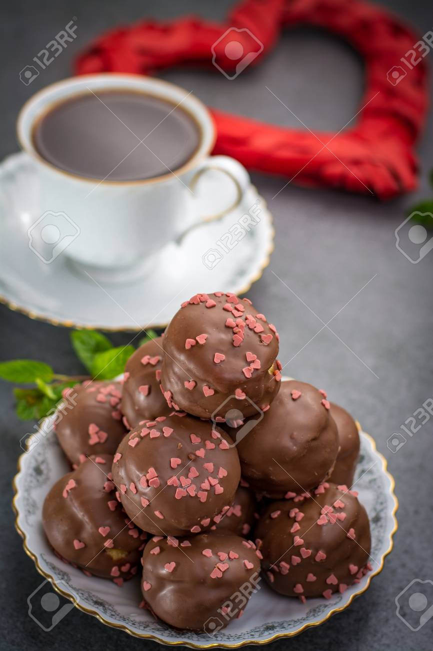Valentine S Day Concept Chocolate Profiteroles With Pink Hearts