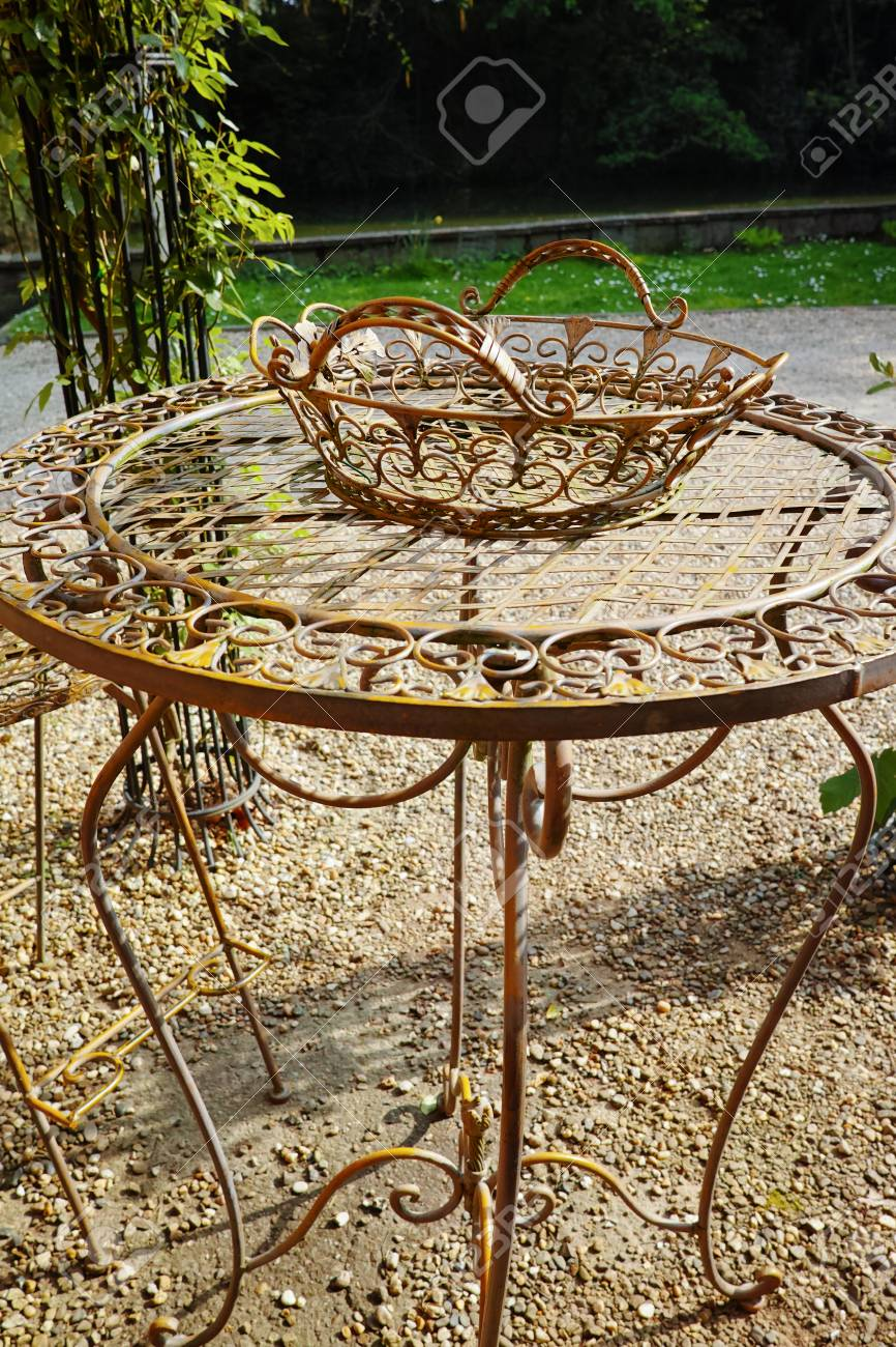 Elegant antique patterned iron garden furniture set high table and chairs stock photo 99998543