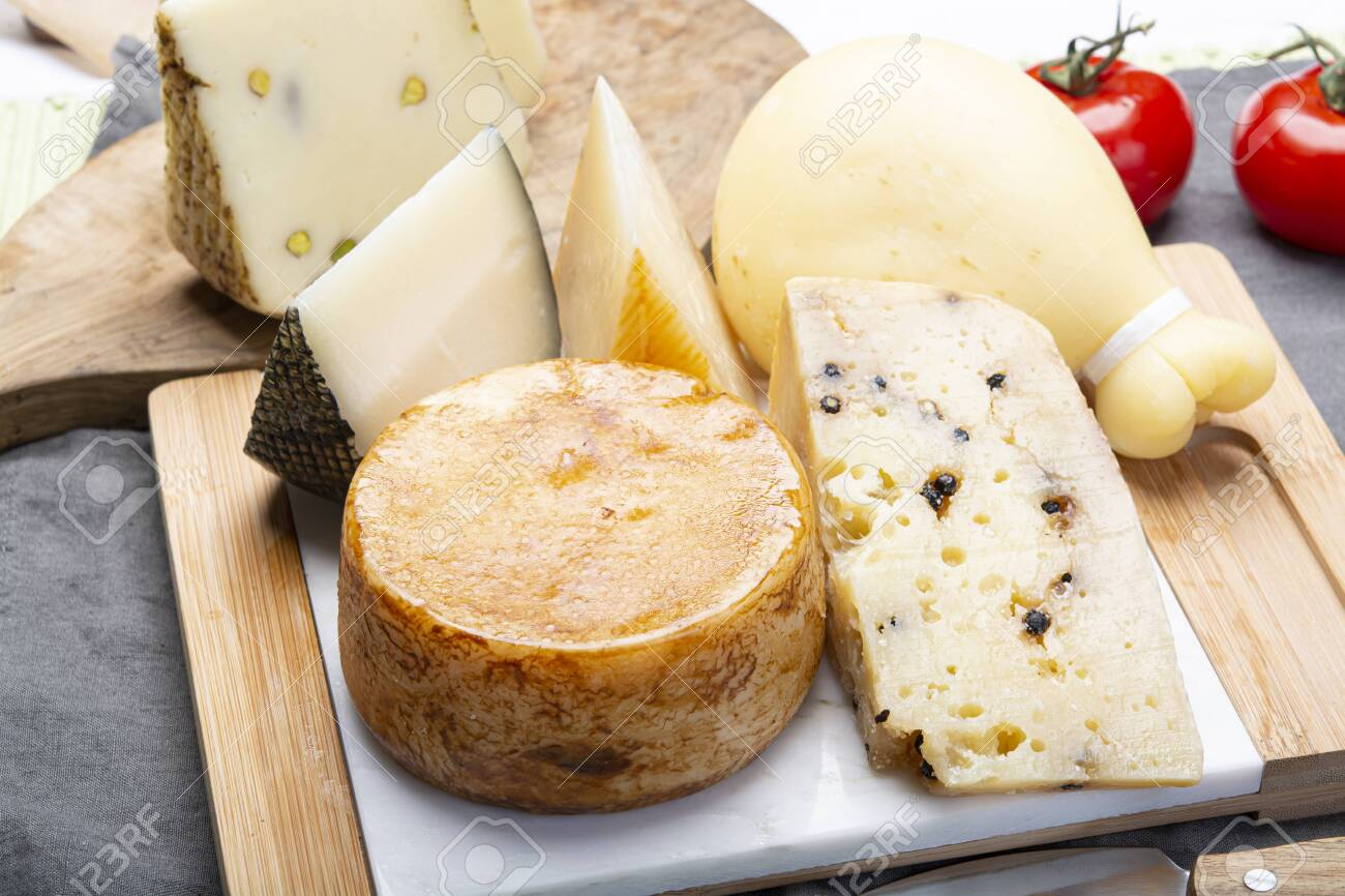 Cheese collection, Variety of Italian pecorino and provolone cheeses, aged with black peppers from Nebrodi, white Il Palio and black molarotto, close up - 125395361