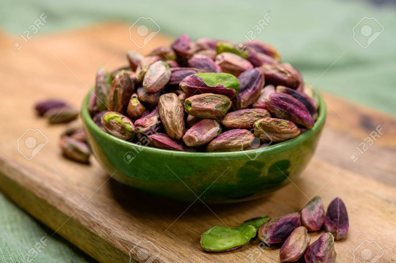 High quality green pistachio nuts growing on slopes of Mount Etna in Bronte, Sicily, Italy, close up - 136382611