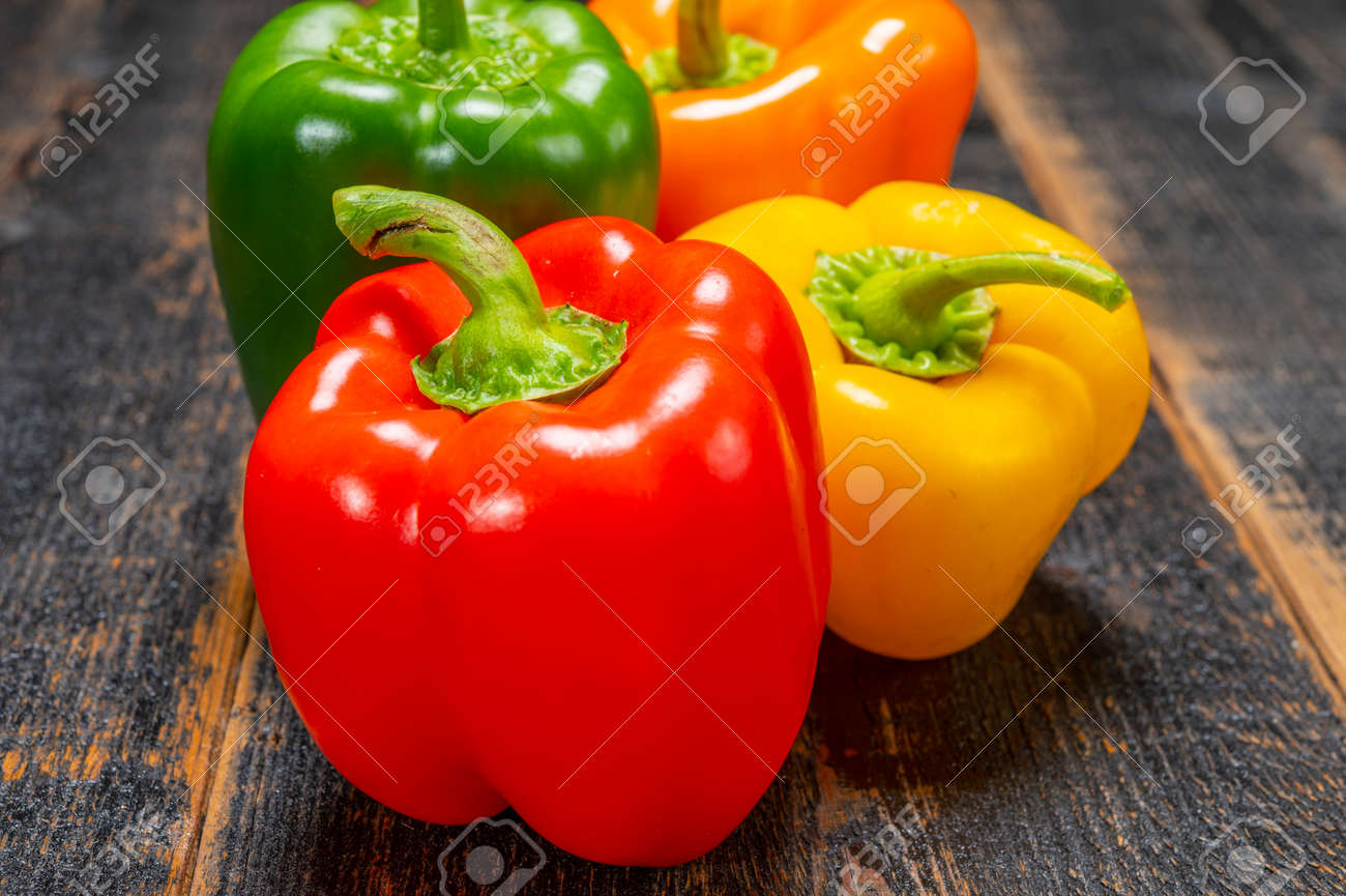 Fresh red, orange, green and yellow sweet bell paprika close up - 143886511