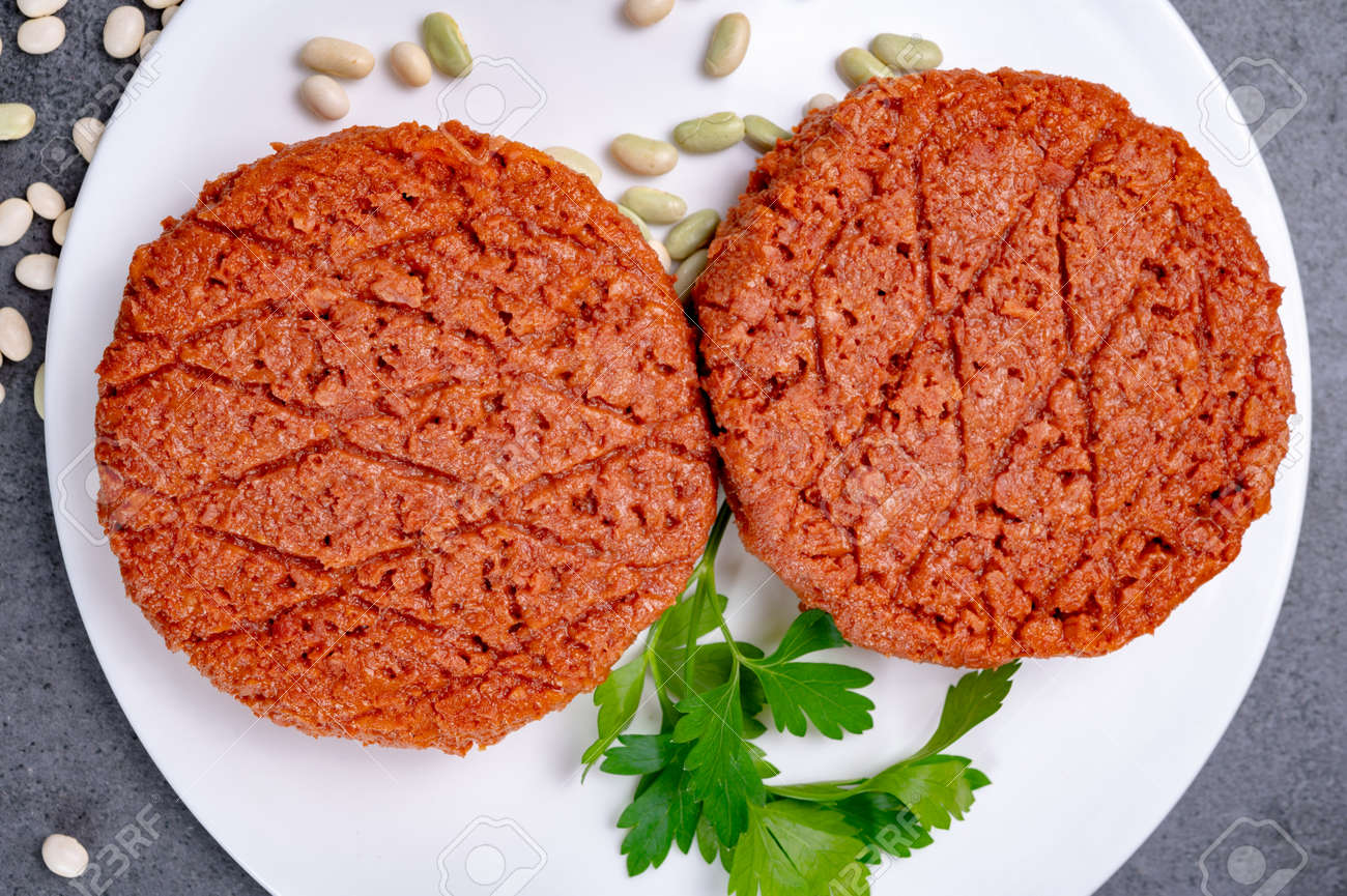 Tasty uncooked burger made with vegetarian plant based imitation minced soya beans meat ready for grill - 164681161