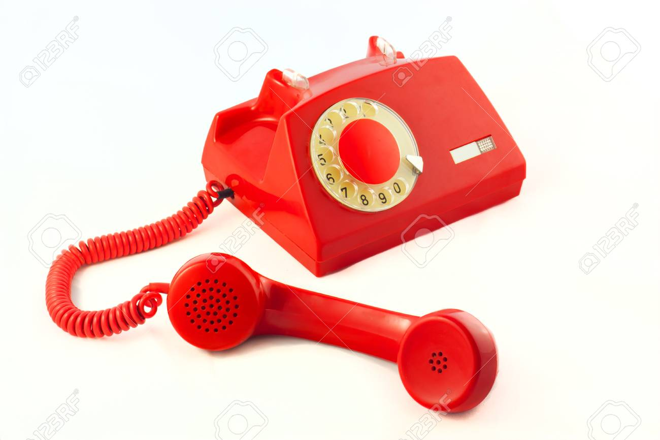 Old red plastic phone on a white background. Stock Photo - 11674972