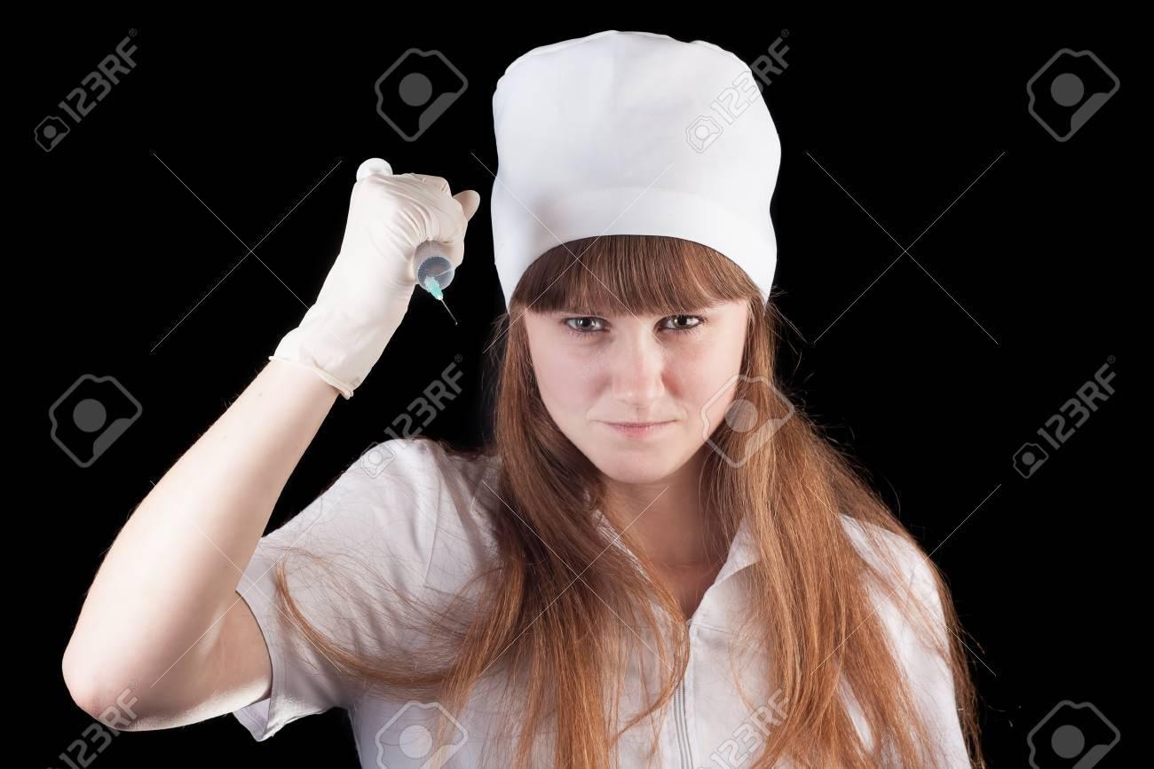 Nurse hold syringe in hand on a black background Stock Photo - 16757913