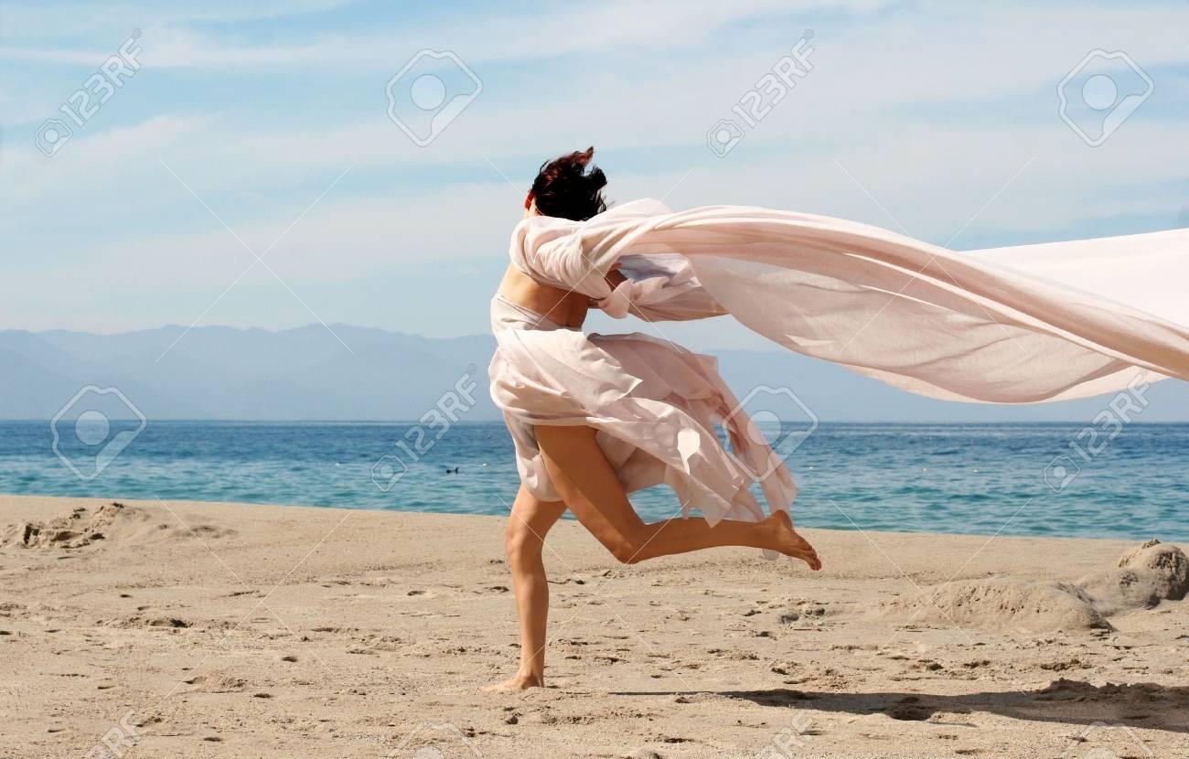 Happy woman on the beach Stock Photo - 280544