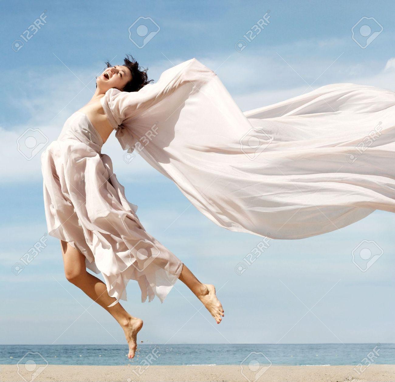 Happy woman on the beach Stock Photo - 280543