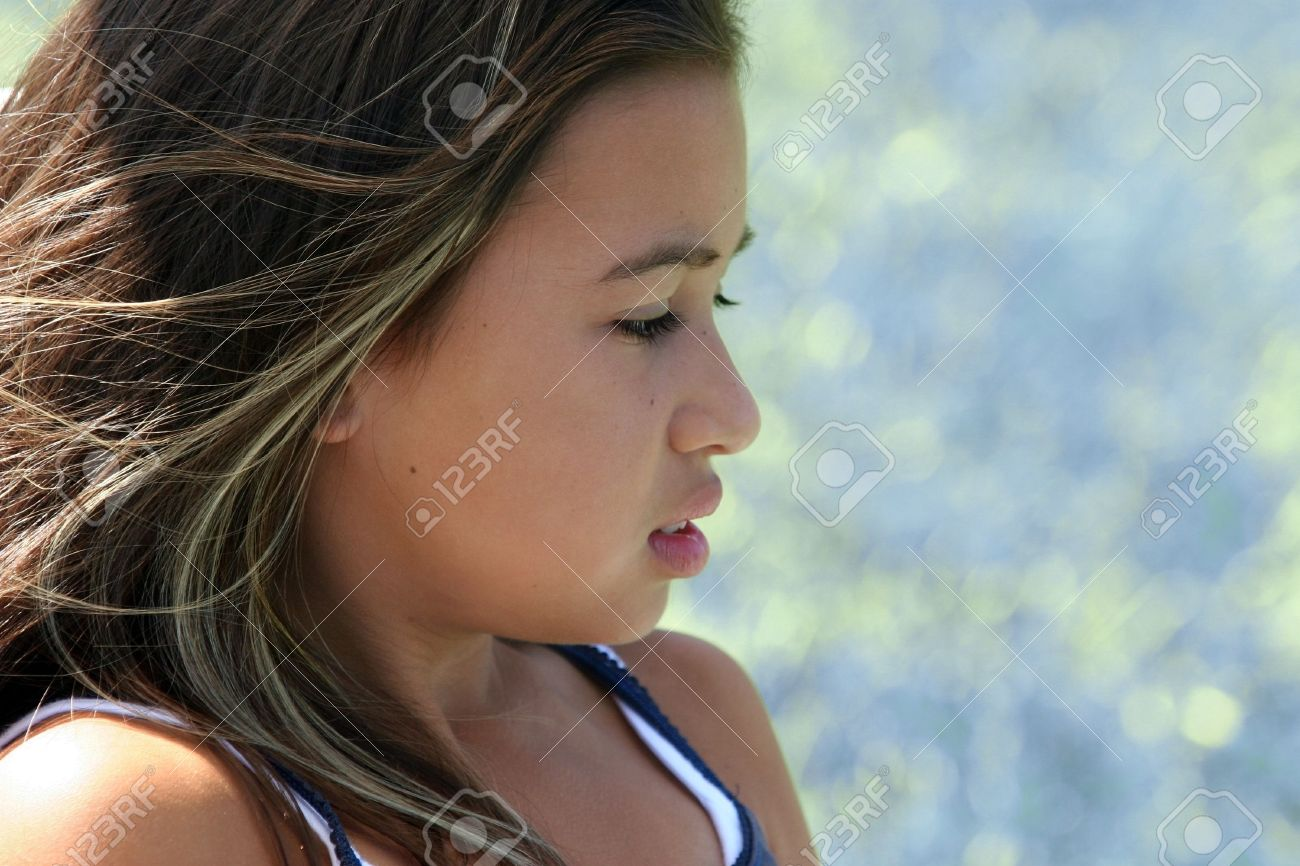 Cute Teens profile of a cute teenage girl stock photo, picture and royalty