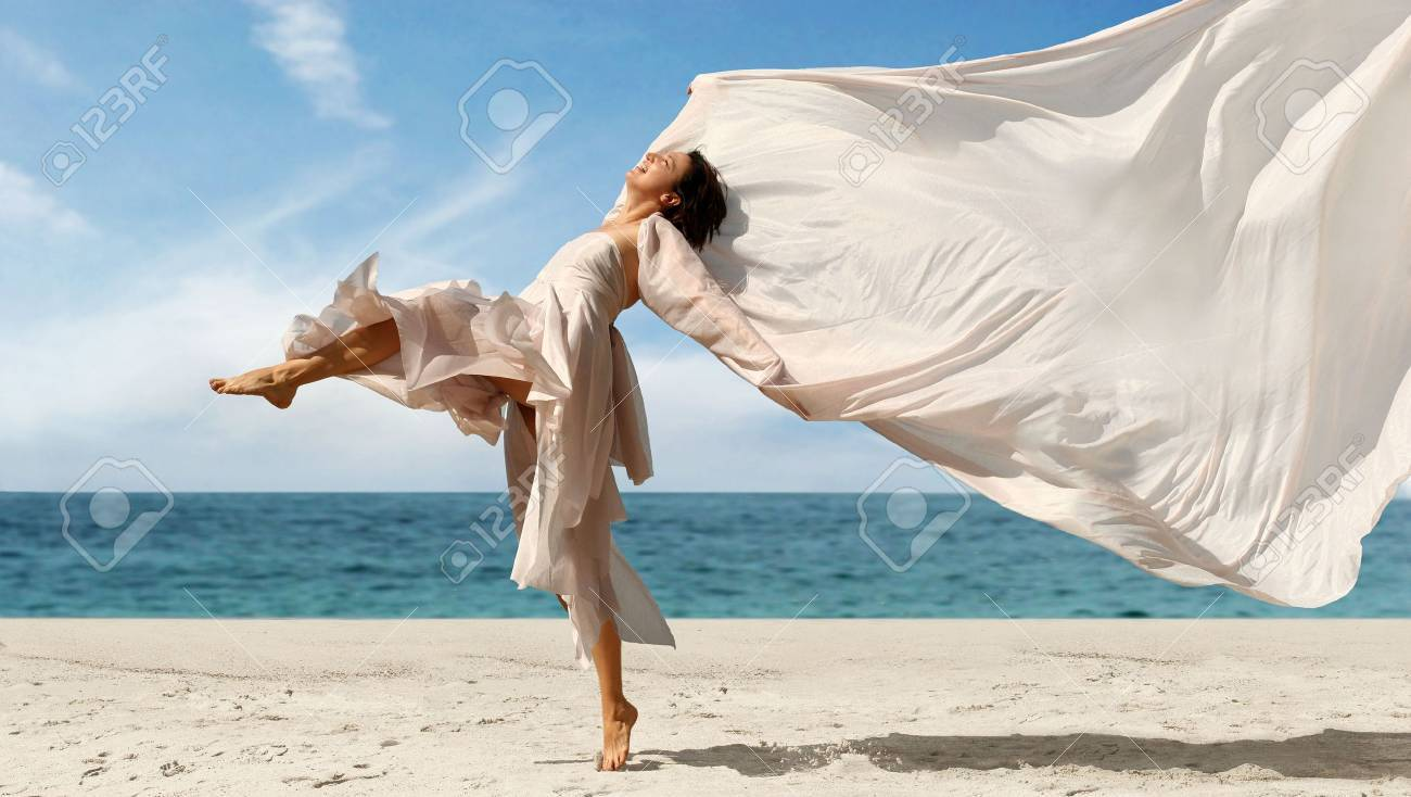 Happy woman with a scarf on the beach Stock Photo - 326312