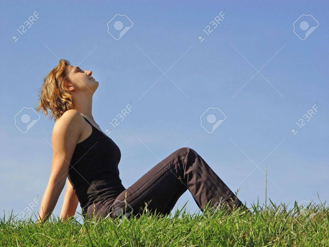 Beautiful woman sitting in the grass Stock Photo - 347538