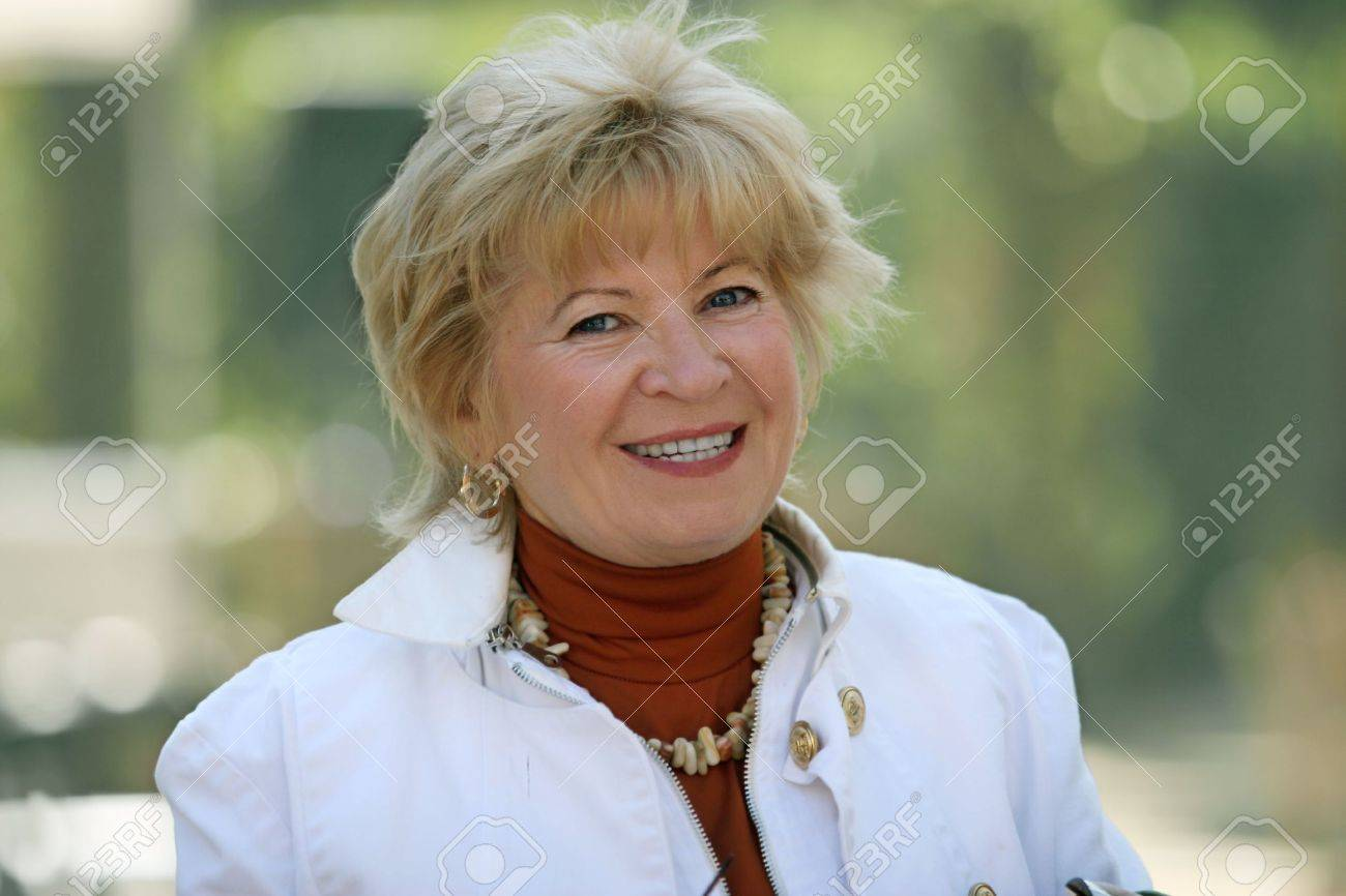 Outdoor portrait of a happy blond mature woman Stock Photo - 598509