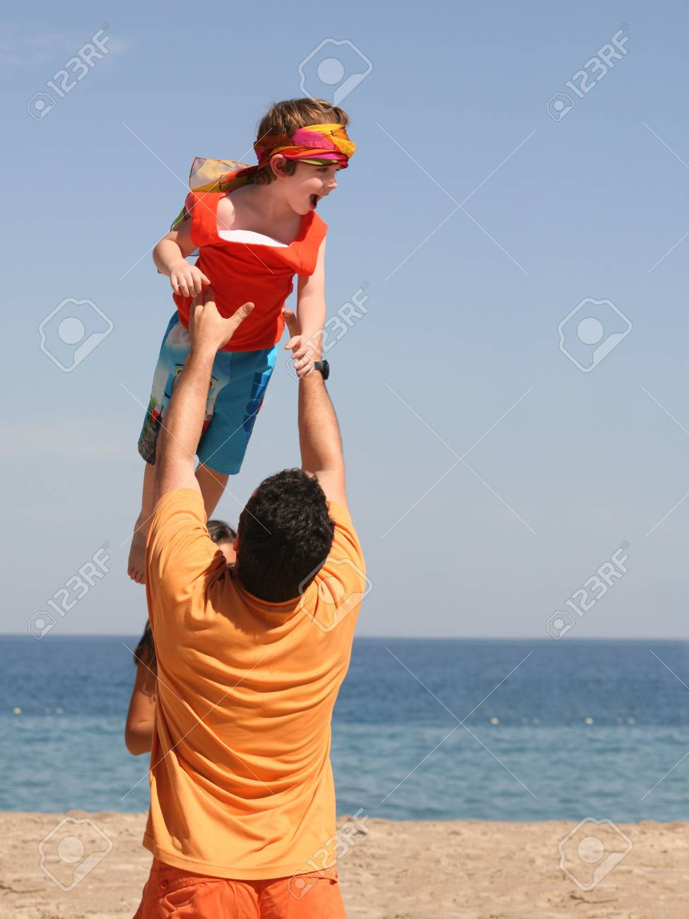 Father playing with his son on the beach Stock Photo - 751140