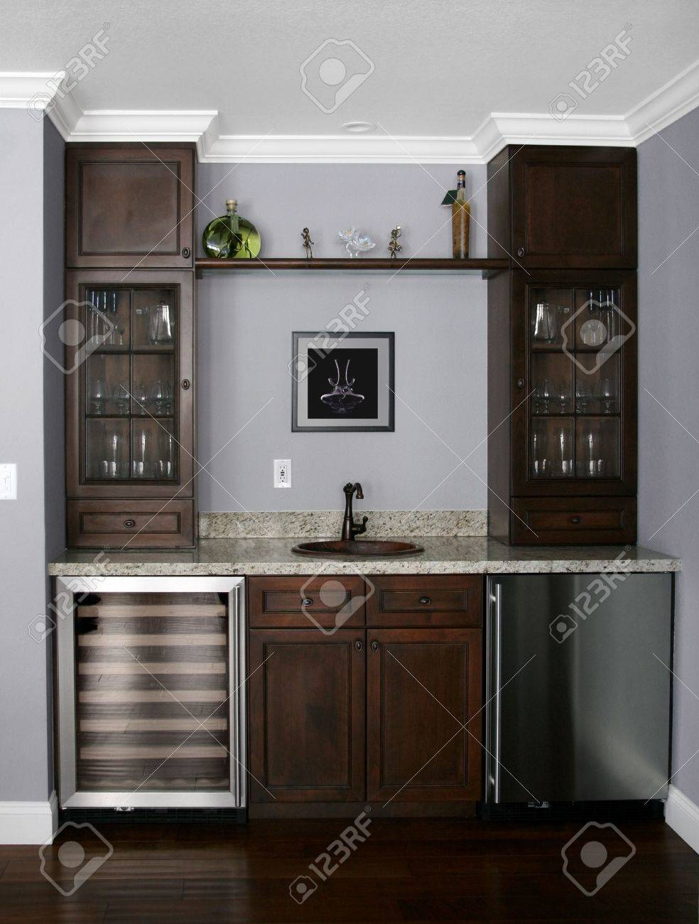 http://previews.123rf.com/images/barsik/barsik0703/barsik070300055/802099-Details-of-a-wet-bar-in-modern-house-he-picture-on-the-wall-is-my-own-image-Stock-Photo.jpg