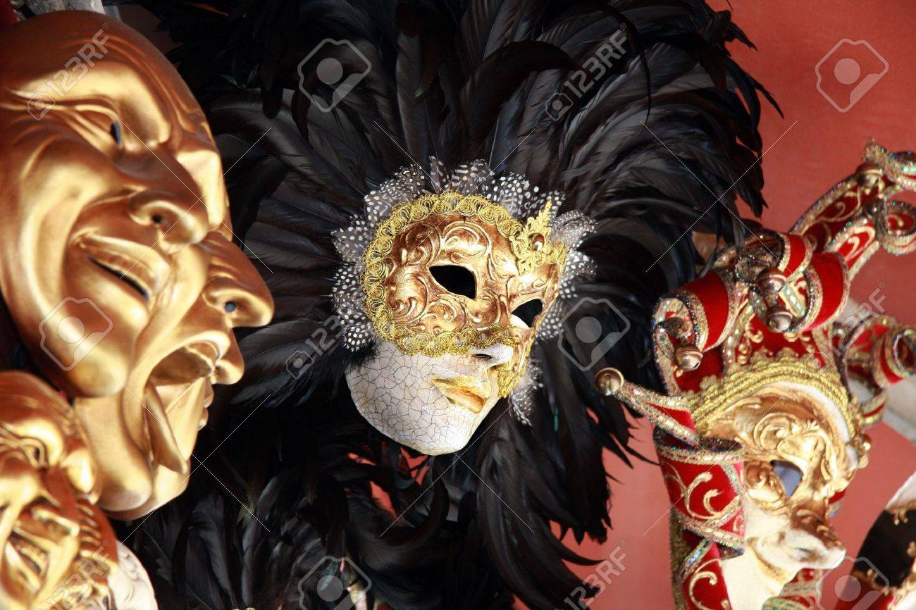 Venetian masks with black feathers on a red background Stock Photo - 3648128
