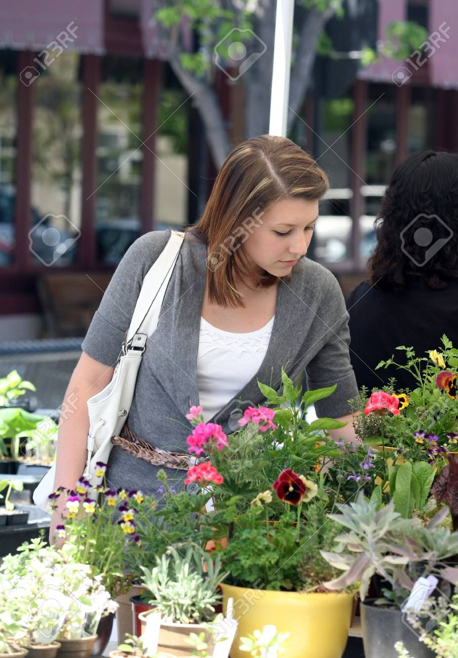 A young woman buying herbs for her garden Stock Photo - 4739118