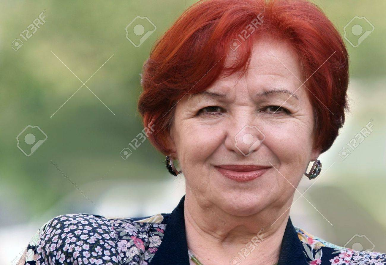 Portrait of a smiling woman in her seventies Stock Photo - 4863145