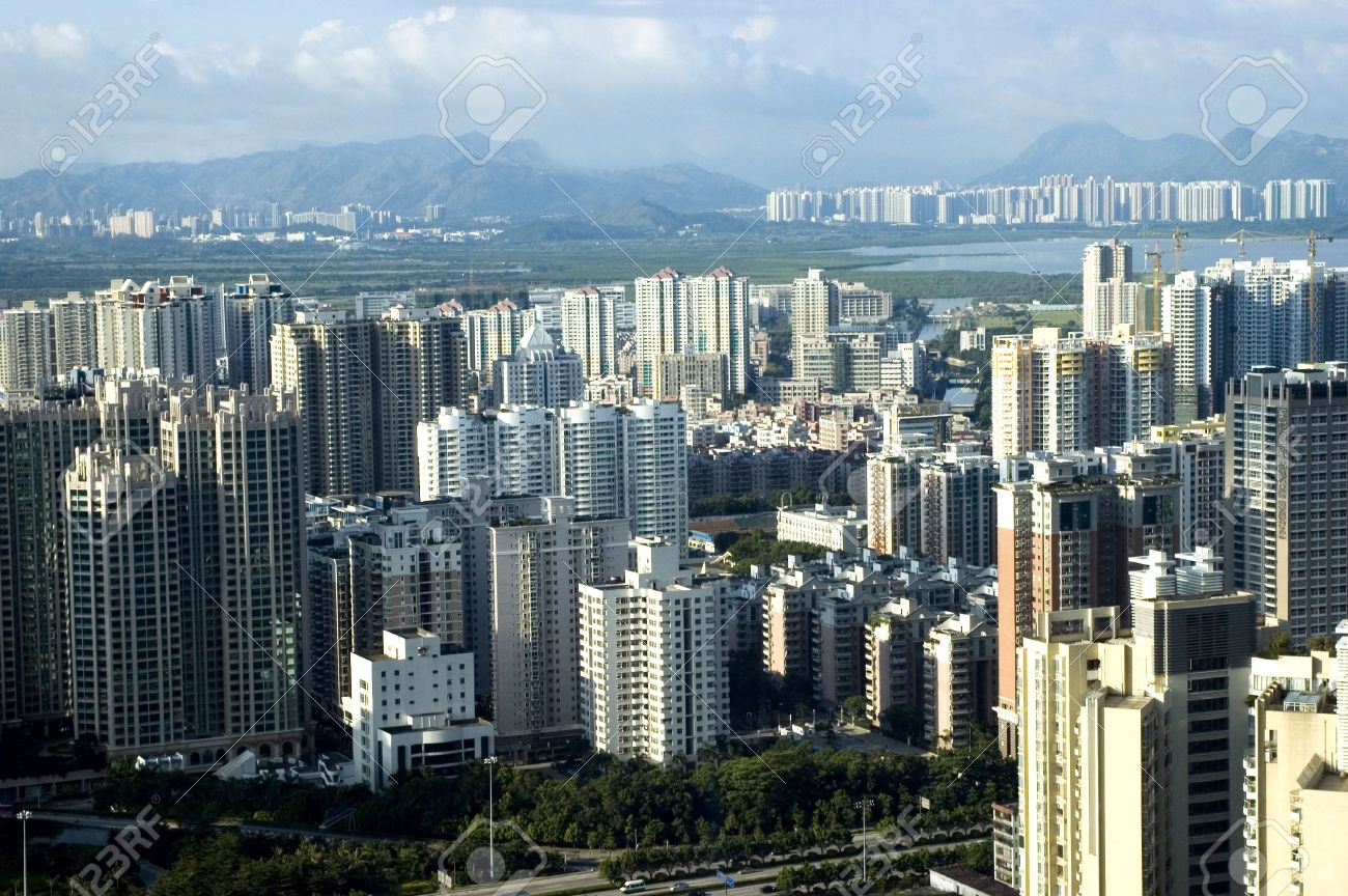 Chinese metropolis - modern Shenzhen city with office's skyscrapers, hotels and residential buildings. Stock Photo - 3498087