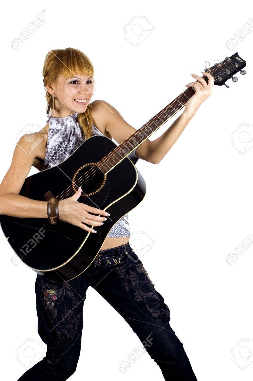 Pretty, blonde girl holding guitar, happy, laughing and playing music. Stock Photo - 3814996