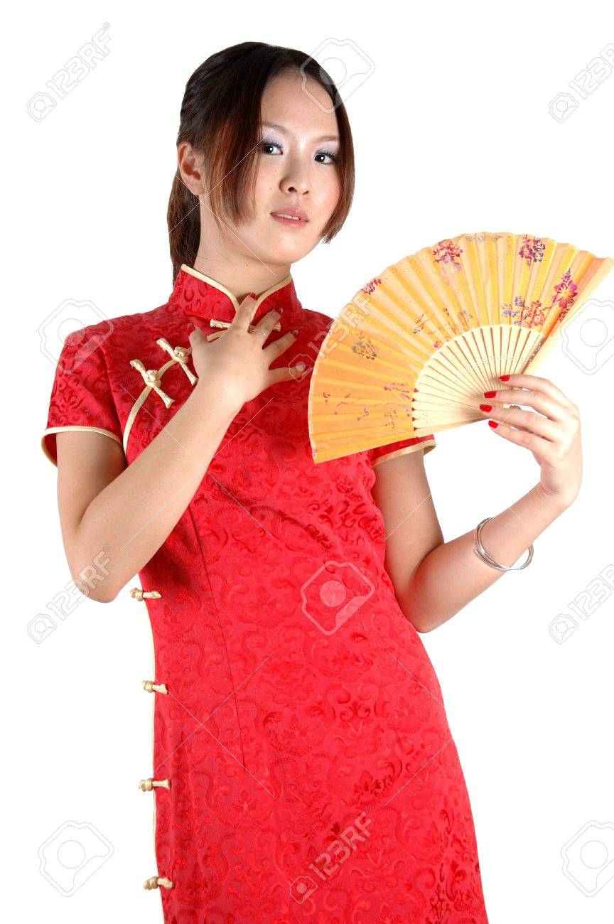 Chinese model in traditional dress called QiPao, holding fan. Asian cute girl, young model with friendly and happy face expression. Stock Photo - 8471757