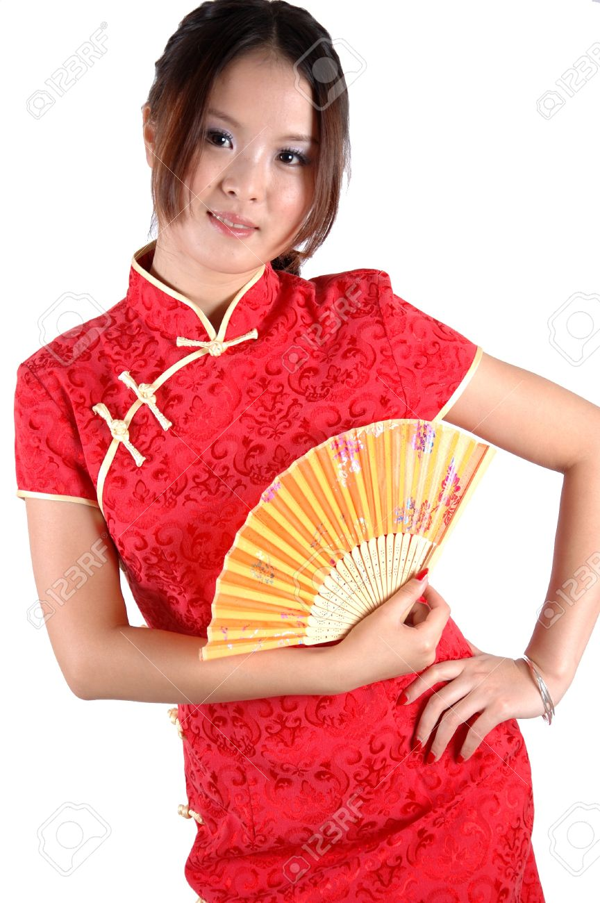 Chinese model in traditional dress called QiPao, holding fan. Asian cute girl, young model with friendly and happy face expression. Stock Photo - 8471770