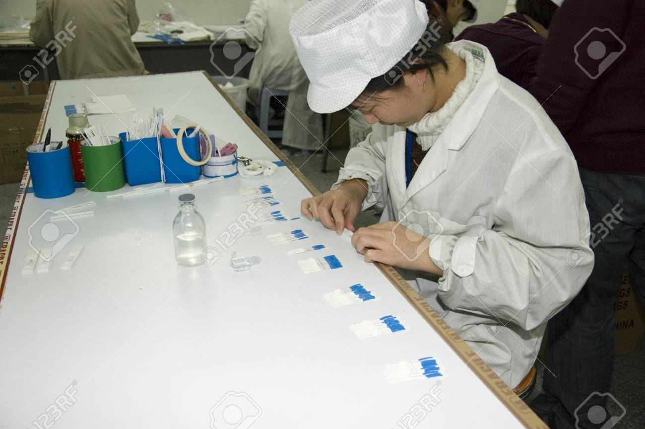 CHINA, SHENZHEN - DECEMBER 18: pregnancy test production in China, factory tour on December 18, 2009 in Shenzhen. Stock Photo - 9338147
