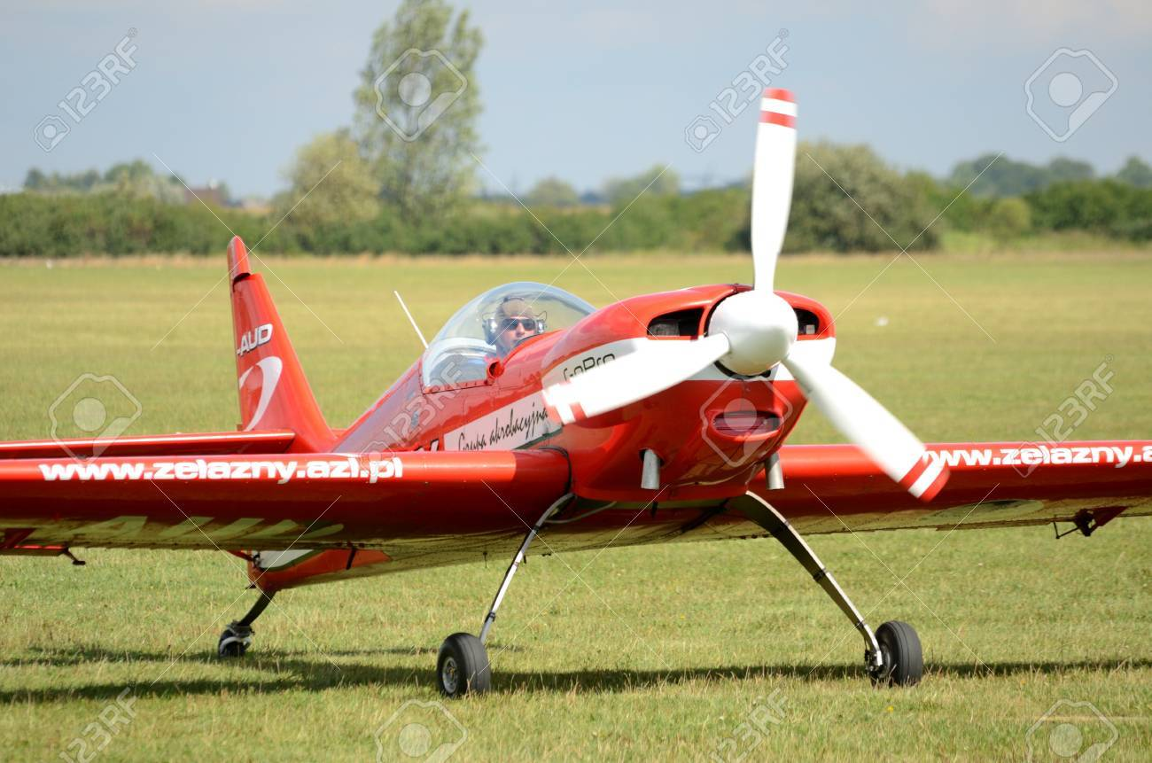 SZYMANOW, POLAND - AUGUST 25: Pilot Piotr Haberland arrives back after acrobatic show in plane Zlin-50 LS on August 25, 2012 in Szymanow. - 14986163