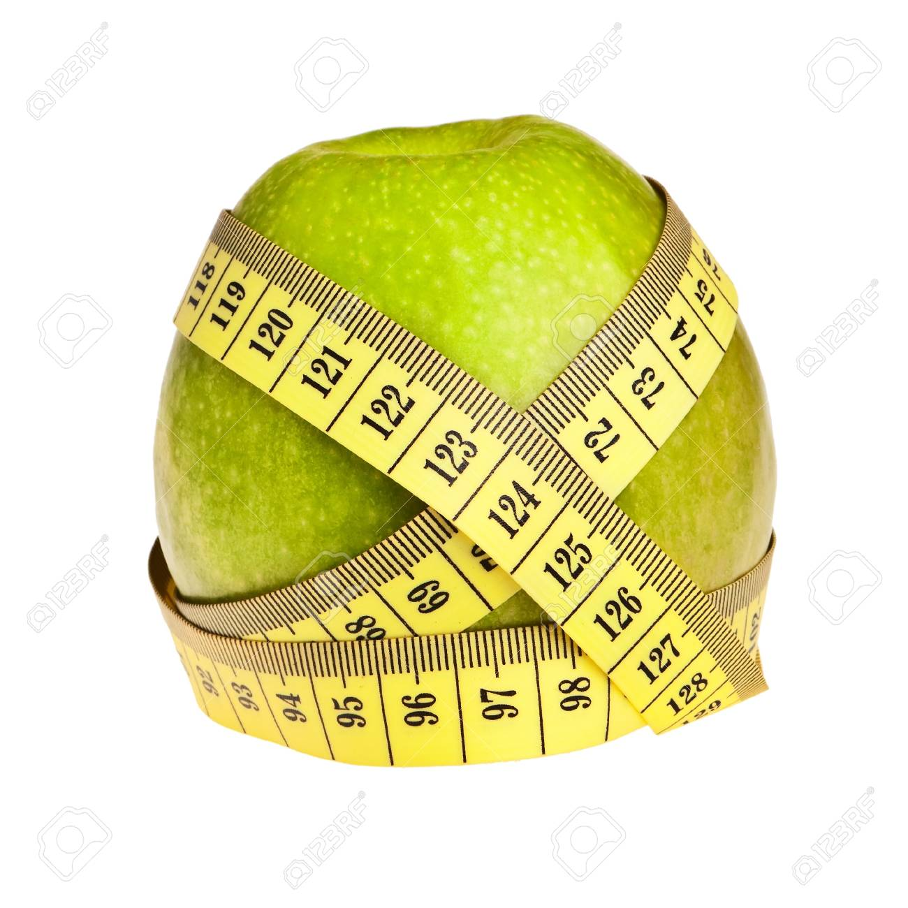 Green apple wrapped with yellow measurement tape over white background. Stock Photo - 8792422